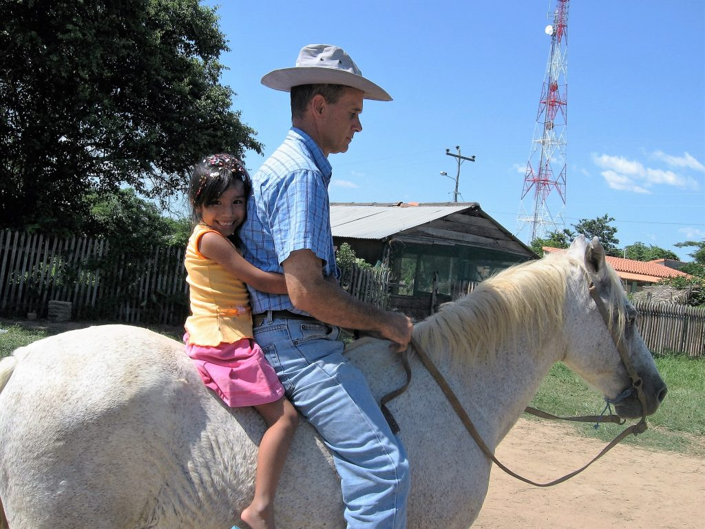 Here's Terry at the church plant compound next to his house in San Julian, Bolivia. He is taking his daughter, Marilu for a ride on her birthday present. He was unable to resist the cuteness of her request.